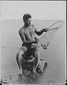 Hawaiian fisherman retrieving fish from small net (PP-22-1-008).jpg