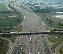 An aerial image of an 18-lane freeway. The freeway is divided into four seperate set of lanes, known as carriageways.