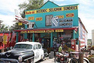 Seligman, Arizona - Historic Seligman Sundries Building, on old Route 66. Yellow 1972 Ford Ranchero on right.