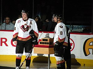 2008–09 WHL season - Calgary Hitmen forwards Carson McMillan and Kyle Bortis accept the Scotty Munro Memorial Trophy as the 2008–09 regular season champions.