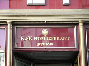 Royal warrant of appointment - Imperial eagle displayed at the store of the purveyor Rudolf Waniek, in Vienna