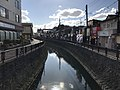 Horikawa Canal in front of east entrance of Orio Station.jpg