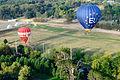 Hot air balloons landing in Canberra 1.JPG
