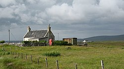 House and telephone box on Baleshare.jpg
