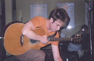 Howie Day - Howie Day adjusting pedals at the Point in Philadelphia, PA circa 2004.