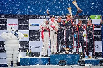 2018 World Rally Championship - Top three crews celebrating on the podium.