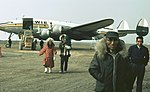 Iñupiat people at Barrow Airport, in front of a Wien Alaska Airlines Constellation.jpg