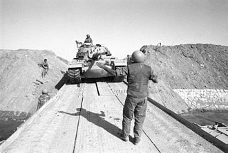 Operation Abirey-Halev - Israeli tank crosses the Suez Canal on a bridge formed by the Combat Engineering Corps