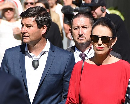 Ardern with her partner, Clarke Gayford (left), at a Waitangi Day event, 2018 Jacinda Ardern and Patsy Reddy on Waitangi Day (crop).jpg