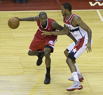 Jamal Crawford - Crawford being defended by Trevor Ariza