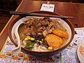 Japanese noodle soup with pig cartilages and octopus pieces and beef.jpg