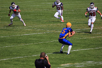 Calgary Colts - August 12, 2012  Amazing play by Saskatoon Hilltop quarterback number 8 Matt Karpinka.  A lateral throw to the wide receiver number 5 Jared Andreychuk.