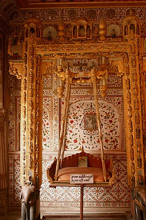 Crafts of India -  Handcrafted swing, (Jhoola) inside the Phool Mahal, Junagarh Fort, Bikaner.