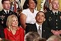 Jill Biden and Barack Obama listen to a speach by Michelle Obama, 2011.jpg
