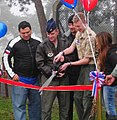 Joshua Kent, with the help of Col. Jay Silveria cut the ribbon and Carlos Mencia Kid Rock and Jessie James cut the ribbon to open new fitness stations at RAF Lakenheath.jpg