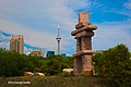 July 2012 Inukshuk at Ontario Place Points to CN Tower (7571973554).jpg