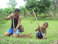 Katang father and son dig for crickets.JPG