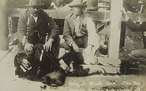 "Tom Ketchum - Sepia-tone photo from a contemporary postcard showing Tom Ketchum's decapitated body. Caption reads ""Body of Black Jack after the hanging showing head snapped off."""