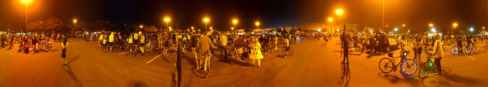 panorama of San Jose Bike Party including crowd with lots of bicycles at a regroup point on June 21, 2019