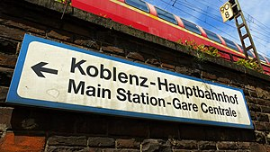 Central station - A Deutsche Bahn sign giving directions in three languages to Koblenz Hauptbahnhof.