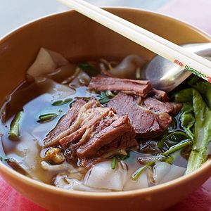 Beef noodle soup - A bowl of kuaitiao nuea pueay in Chiang Mai, Thailand. This the Thai version of braised beef noodles