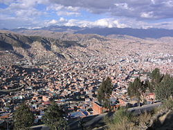 A view of La Paz with the Cordillera Real in the background. Jathi Qullu of the Yanacachi Municipality lies in the sector shown in the upper left part of this image.