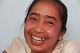 Laughing Laotian woman showing her teeth.jpg