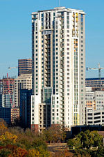 The 31 story building from the south. The building is a rectangular prism with some setbacks on the side facing the viewer.