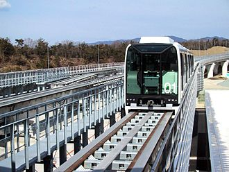 Linimo - Linimo train approaching Banpaku Kinen Koen, in the direction of Fujigaoka Station