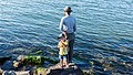Little boy with his father fishing (21102524443).jpg