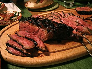 Steak - London broil is a North American beef dish made by broiling or grilling marinated flank steak, then cutting it across the grain into thin strips.