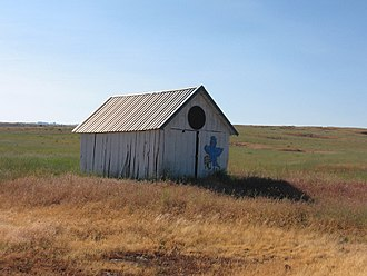 Bickleton, Washington - A lonely shed outside of Bickleton proudly showing the bluebird connection.