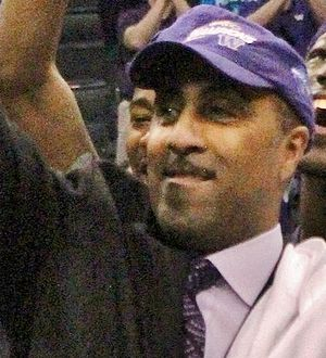 Lorenzo Romar - Romar celebrates Washington's 2011 Pac-10 Tournament championship.