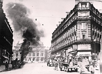 Liberation of Paris - August 25 - Armoured vehicles of the 2nd Armored (Leclerc) Division fighting before the Palais Garnier. One German tank is going up in flames