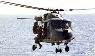 HMS Cardiff (D108) - Cardiffs helicopter, piloted by Lieutenant Christopher Clayton, practising search and rescue prior to the war