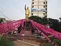 Madhava Reddy statue surrounded by TRS flags.JPG