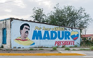 """Bolivarian propaganda - A political painting saying, """"For the love of Chávez. President Maduro."""" with the popular """"Chávez eyes"""" visible."""