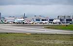 Mandarin Airlines Embraer 190 B-16826 and TransAsia Airways Airbus A321-231 B-22610 Stand by at Taipei Songshan Airport 20150321.jpg
