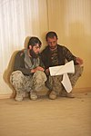 Marine advisors take an over-the-shoulder approach to training the Afghan police 130617-M-CD983-089.jpg
