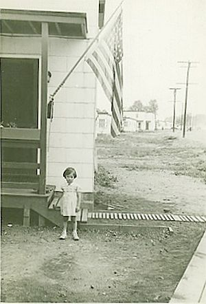 Winfield Township, New Jersey - Mary Louise Burke in front of her new home at 1B Seafoam Avenue, Spring, 1942. Winfield Park, Winfield Township, New Jersey.