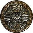 Een goud-en-zilveren munt met vijf wapenschilden, drie gekroond, en de ketting van de Orde van het Gulden Vlies.  De munt is omgeven door tekst.