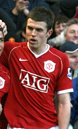 83624f47e36 Carrick celebrates a goal with Cristiano Ronaldo (left) in the Manchester  derby in a 3–1 home win on 9 December 2006