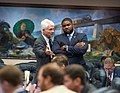 Michael Grant and Byron Donalds confer on the House floor.jpg