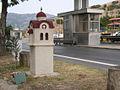 Miniature church sideways at Korinos toll station, A1 motorway, Greece.jpg