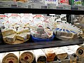 Mixed cheeses in the supermarket.jpg