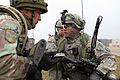 Moldovan army Capt. Deli Ianec, left, role-playing as an Afghan National Army officer, and U.S. Army Capt. Trey Marsh, with Iron Troop, 3rd Squadron, 2nd Cavalry Regiment, review pictures taken after a search 130311-A-PU716-004.jpg