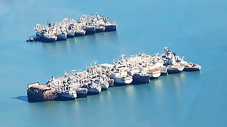 National Defense Reserve Fleet - Mothballed ships in Suisun Bay, California in 2010. The battleship Iowa can be seen at the far end of the first row