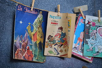 Comic book - Comic books on display at a museum, depicting how they would have been displayed at a rail station store in the first half of the 20th century.