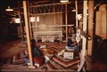 NAVAJO WOMEN WEAVE A RUG AT THE HUBBEL TRADING POST, FIRST TRADING POST ON THE NAVAJO RESERVATION - NARA - 544416.tif