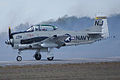 North American T-28C Trojan Sherry Berry Landing 04 TICO 13March2010 (14619580763).jpg